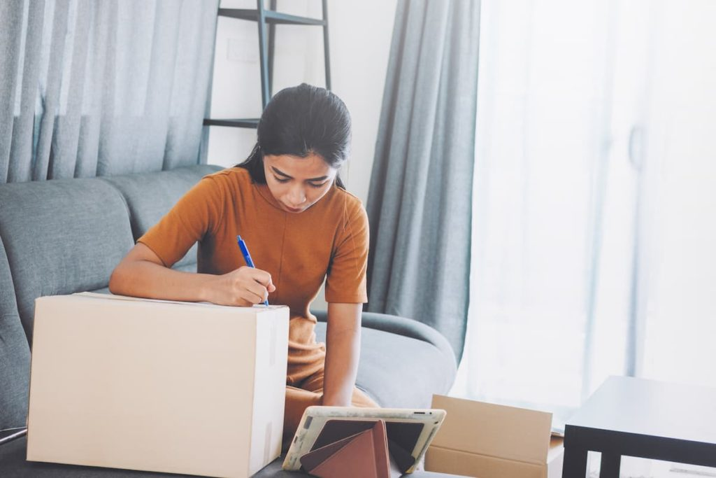 A woman creates a home inventory for insurance purposes as directed by Cal Homes